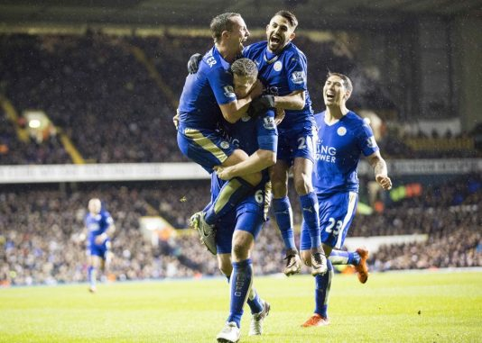 Football - 2015 / 2016 Premier League - Tottenham vs Leicester. Leicester's Daniel Drinkwater and Riyad Mahrez leap on Robert Huth as they they celebrate his goal at White Hart Lane. (Photo by Daniel Bearham/Colorsport/Icon Sportswire) ****NO AGENTS----NORTH AND SOUTH AMERICA SALES ONLY----NO AGENTS----NORTH AND SOUTH AMERICA SALES ONLY****