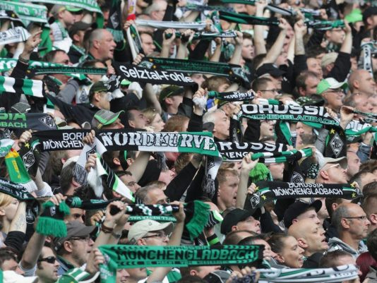 MOENCHENGLADBACH, GERMANY - MAY 03:  Fans of Moenchengladbach support their team during the Bundesliga match between Borussia Moenchengladbach and Mainz 05 at Borussia-Park on May 3, 2014 in Moenchengladbach, Germany.  (Photo by Juergen Schwarz/Bongarts/Getty Images)