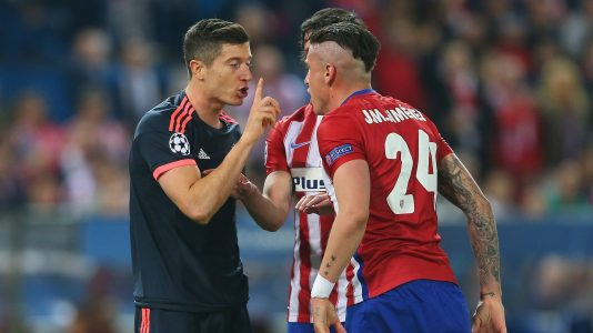 MADRID, SPAIN - APRIL 27:  Jose Gimenez of Atletico Madrid and Robert Lewandowski of Bayern Munich argue as Stefan Savic of Atletico Madrid intervenes during the UEFA Champions League semi final first leg match between Club Atletico de Madrid and FC Bayern Muenchen at Vincente Calderon on April 27, 2016 in Madrid, Spain.  (Photo by Alexander Hassenstein/Bongarts/Getty Images)