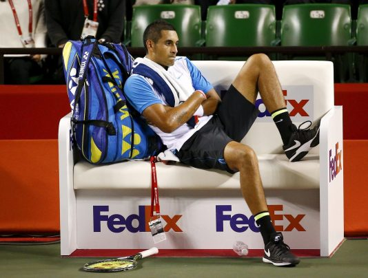 Nick Kyrgios of Australia sits on the bench during his men's singles tennis match against Benoit Paire of France at the Japan Open championships in Tokyo October 9, 2015.   REUTERS/Thomas Peter - RTS3P98