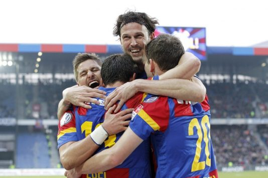 Basel's Alex Frei, center, reacts with Basel's Marco Streller, top, and Basel's Fabian Frei, right, after scoring 3-1 during the Super League soccer match between FC Basel and FC Luzern at the St. Jakob-Park stadium in Basel, Switzerland, on Sunday, March 4, 2012. (KEYSTONE/Alessandro Della Bella)