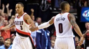 Apr 27, 2015; Portland, OR, USA; Portland Trail Blazers guard C.J. McCollum (3) and guard Damian Lillard (0) high five after a basket against the Memphis Grizzlies during the fourth quarter in game four of the first round of the NBA Playoffs at the Moda Center. Mandatory Credit: Craig Mitchelldyer-USA TODAY Sports
