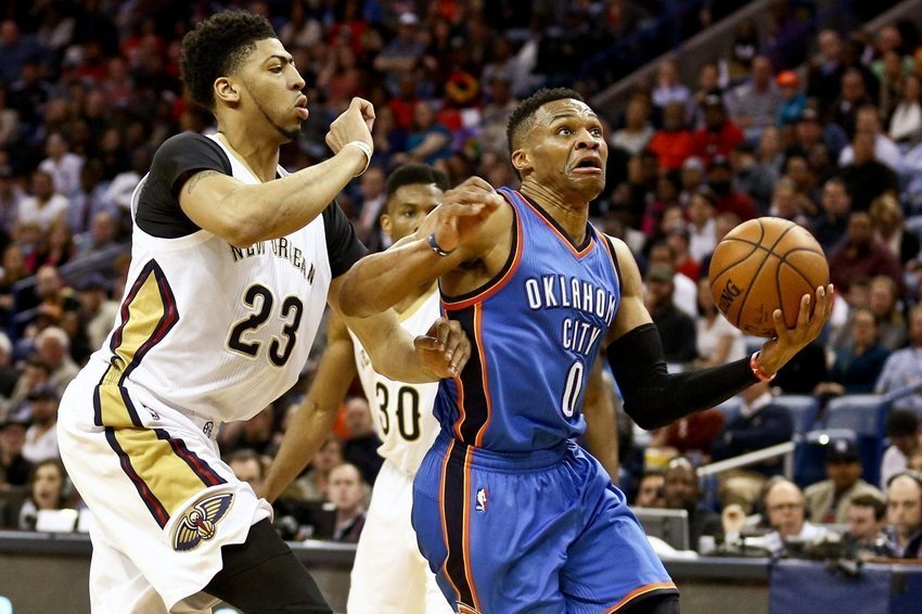 Feb 25, 2016; New Orleans, LA, USA; Oklahoma City Thunder guard Russell Westbrook (0) drives past New Orleans Pelicans forward Anthony Davis (23) during the second quarter of a game at Smoothie King Center. Mandatory Credit: Derick E. Hingle-USA TODAY Sports