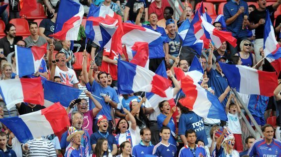 Supporters of French national football team wave flags prior to the friendly football match France vs Iceland (3-2) on May 27, 2012, at the Hainaut Stadium in Valenciennes. AFP PHOTO /  FRANCK FIFE        (Photo credit should read FRANCK FIFE/AFP/GettyImages)