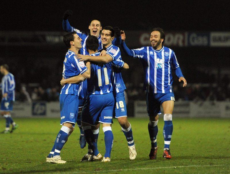 Brighton's Christian Baz celebrates scoring the winning penalty during the first round replay match at Kingfield Stadium, Woking.