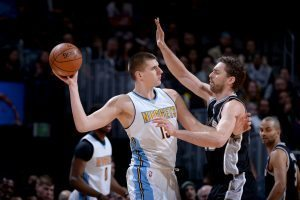 DENVER, CO - JANUARY 5:  Nikola Jokic #15 of the Denver Nuggets handles the ball against the San Antonio Spurs on January 5, 2017 at the Pepsi Center in Denver, Colorado. NOTE TO USER: User expressly acknowledges and agrees that, by downloading and/or using this Photograph, user is consenting to the terms and conditions of the Getty Images License Agreement. Mandatory Copyright Notice: Copyright 2016 NBAE (Photo by Bart Young/NBAE via Getty Images)