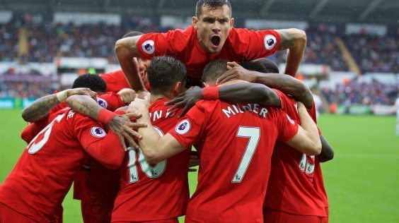 LIVERPOOL, ENGLAND - Saturday, October 1, 2016: Liverpool's Dejan Lovren jumps on the huddle as James Milner celebrates scoring the second goal against Swansea City from the penalty spot to make the score 2-1 during the FA Premier League match at the Liberty Stadium. (Pic by David Rawcliffe/Propaganda)
