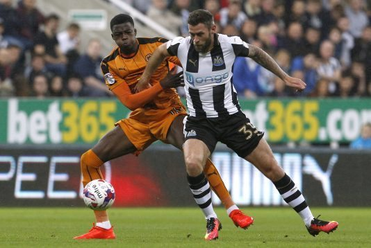 """Britain Football Soccer - Newcastle United v Wolverhampton Wanderers - EFL Cup Third Round - St James' Park - 20/9/16 Wolves' Dominic Iorfa (L) in action with Newcastle United's Daryl Murphy Mandatory Credit: Action Images / Craig Brough Livepic EDITORIAL USE ONLY. No use with unauthorized audio, video, data, fixture lists, club/league logos or """"live"""" services. Online in-match use limited to 45 images, no video emulation. No use in betting, games or single club/league/player publications. Please contact your account representative for further details."""