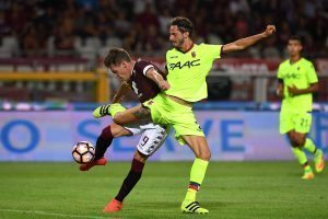 TURIN, ITALY - AUGUST 28:  Andrea Belotti (L) of FC Torino is challenged by Marios Oikonomou of Bologna FC during the Serie A match between FC Torino and Bologna FC at Stadio Olimpico di Torino on August 28, 2016 in Turin, Italy.  (Photo by Valerio Pennicino/Getty Images)