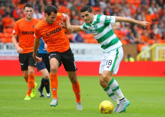22.08.2015. Dundee, Scotland. Scottish Premier League. Dundee United versus Celtic. Tom Rogic and Ryan McGowan battle for the ball