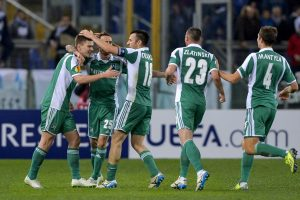 PFC Ludogorets Razgrad's Slovenian forward Roman Bezjak (L) celebrates with his teammates after scoring against Lazio during the UEFA round of 32 Europa League football match Lazio vs PFC Ludogorets Razgrad at Rome's Olympic stadium, on February 20, 2014. AFP PHOTO / ANDREAS SOLARO
