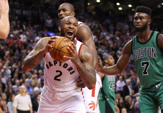 Feb 24, 2017; Toronto, Ontario, CAN; Toronto Raptors forward P.J. Tucker (2) reacts after securing a rebound inside the final minute of play against the Boston Celtics at Air Canada Centre. The Raptors beat the Celtics 107-97. Mandatory Credit: Tom Szczerbowski-USA TODAY Sports