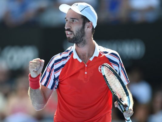 Mikhail Kukushkin of Kazakhstan celebrates a point against Leonardo Mayer of Argentina during their men's semi-final match at the Apia International tennis tournament in Sydney, Friday, Jan. 16, 2015. (AAP Image/Deam Lewins) NO ARCHIVING, EDITORIAL USE ONLY