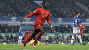 Liverpool's Senegalese midfielder Sadio Mane celebrates scoring his team's first goal during the English Premier League football match between Everton and Liverpool at Goodison Park in Liverpool, north west England on December 19, 2016. / AFP / Oli SCARFF / RESTRICTED TO EDITORIAL USE. No use with unauthorized audio, video, data, fixture lists, club/league logos or 'live' services. Online in-match use limited to 75 images, no video emulation. No use in betting, games or single club/league/player publications.  /         (Photo credit should read OLI SCARFF/AFP/Getty Images)