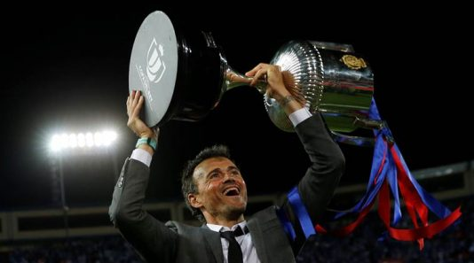 Football Soccer - FC Barcelona v Deportivo Alaves - Spanish King's Cup Final - Vicente Calderon Stadium, Madrid, Spain - 27/5/17 Barcelona coach Luis Enrique celebrates with the trophy at the end of the matchReuters / Susana Vera