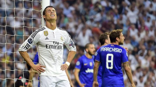 Real Madrid's Portuguese forward Cristiano Ronaldo (L) reacts during the UEFA Champions League semi-final second leg football match Real Madrid FC vs Juventus at the Santiago Bernabeu stadium in Madrid on May 13, 2015. AFP PHOTO/ GERARD JULIEN        (Photo credit should read GERARD JULIEN/AFP/Getty Images)