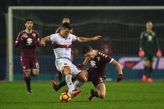 TURIN, ITALY - DECEMBER 22:  Andrea Belotti (R) of FC Torino is tackled by Ezequiel Munoz of Genoa CFC during the Serie A match between FC Torino and Genoa CFC at Stadio Olimpico di Torino on December 22, 2016 in Turin, Italy.  (Photo by Valerio Pennicino/Getty Images)