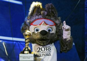 epa05646663 The official mascot of the 2018 FIFA World Cup Wolf with the FIFA Confederations Cup 2017 winner's trophy  during a rehearsal for the draw of the FIFA Confederations Cup 2017 in Kazan, Russia, 25 November 2016. The draw is scheduled for November 26.  EPA/YURI KOCHETKOV